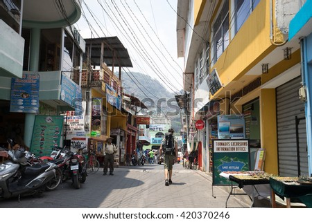 April 20, 2016 San Pedro la Laguna, Guatemala: A backpacker walks on the street of the Mayan town a popular destination for young travelers