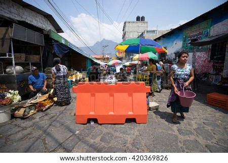 April 17,2016 San Pedro la Laguna: the main street of the town is closed for the duration  of the Sunday market  - stock photo