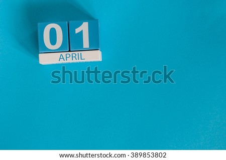 April 1st. Image of april 1 wooden color calendar on blue background.  Spring day, empty space for text. All Fool's Day - stock photo