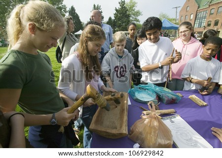 """APRIL 2006 - """"Students view Indian tools during """"Earth Force"""" Earth Day event in Alexandria, Virginia on Potomac River"""" - stock photo"""