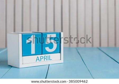 April 15th. Tax Day. Image of april 15 wooden color calendar on white background.  Spring day, empty space for text - stock photo