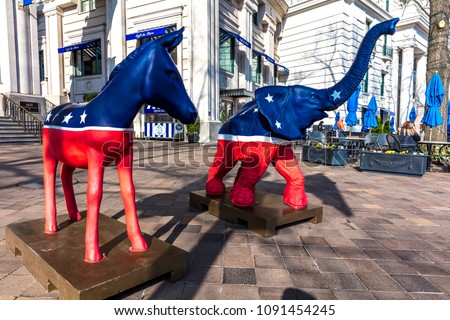 APRIL 11, 2018 - WASHINGTON DC - Democratic Mule and Republican Elephant statues symbolize American 2-part Political system in front of Willard Hotel
