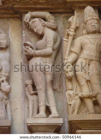 Apsara naked lady washing in morning, sculpture on Varaha Temple, Khajuraho in  India, Asia