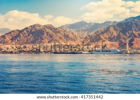 Aqaba, Jordan - November 22, 2007: View on the Aqaba waterfront and Aqaba sea port, Jordan from the Red sea at November 22, 2007 in the harbor of Aqaba, Jordan