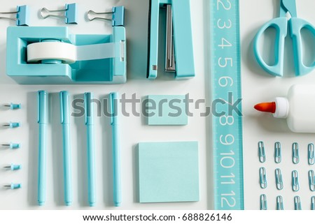 Aqua Blue Office Supplies Arranged In Rows On White Background