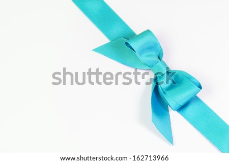 Aqua blue ribbon and bow isolated on white - stock photo