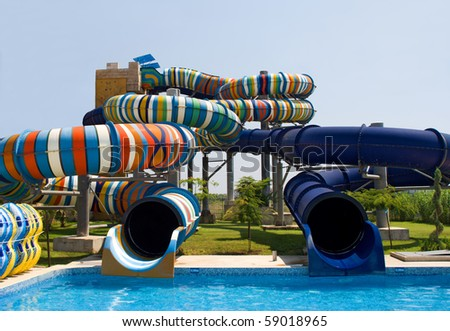 Aqua park in the open air. Summer, sunny day. - stock photo