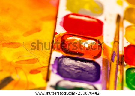 aquarelle paints with brush, shallow depth of field - stock photo