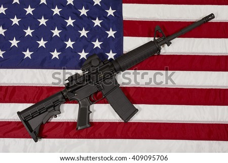 AR15 M4A1 M16 Style Weapon Automatic Rifle on USA Flag concept freedom justice liberty patriotism - stock photo