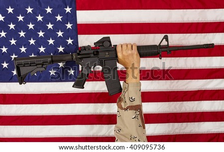 AR15 M4A1 Soldier Man with  M16 Style Weapon Automatic Rifle on USA Flag concept freedom patriotism veteran - stock photo