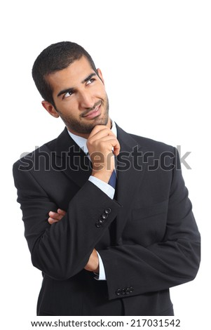 Arab business man thinking smiling looking sideways isolated on a white background - stock photo