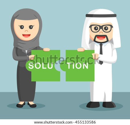 arab businessman and arab businesswoman combining two puzzle solution - stock photo