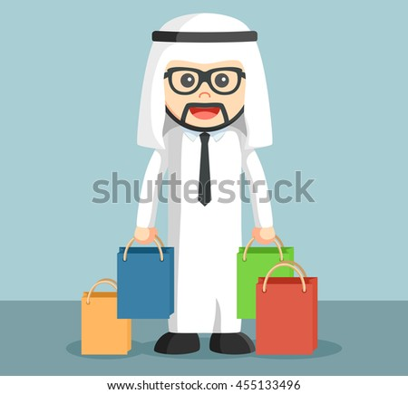arab businessman holding shopping bags - stock photo