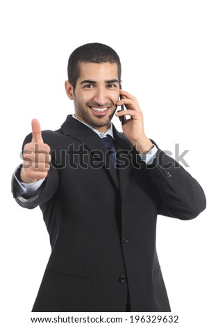 Arab businessman on the mobile phone with thumb up isolated on a white background                 - stock photo
