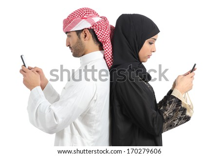 Arab couple addicted to smart phone isolated on a white background              - stock photo
