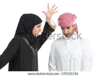 Arab couple with a woman arguing to her husband isolated on a white background              - stock photo