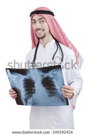 Arab doctor examining x-ray print - stock photo