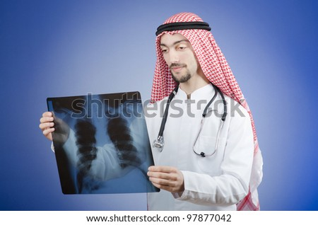 Arab doctor with x-ray print - stock photo