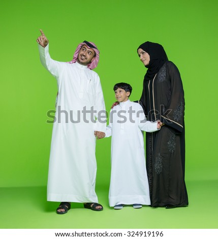 Arab family looking with curiosity - stock photo