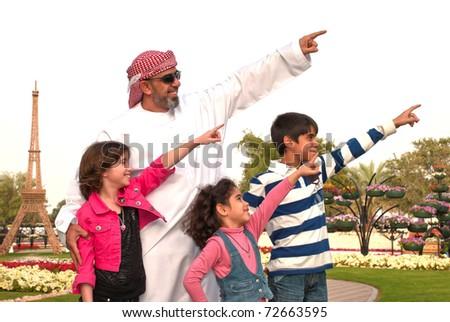 Arab family outdoor - stock photo