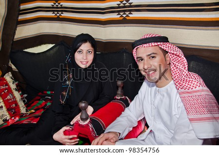 Arab Family setting in traditional Tent - stock photo