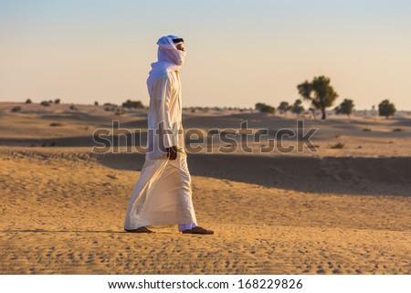 Arab in the Arabian desert on a hot sunny day - stock photo