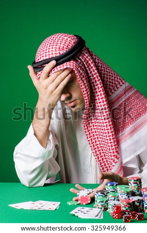 Arab man playing in the casino