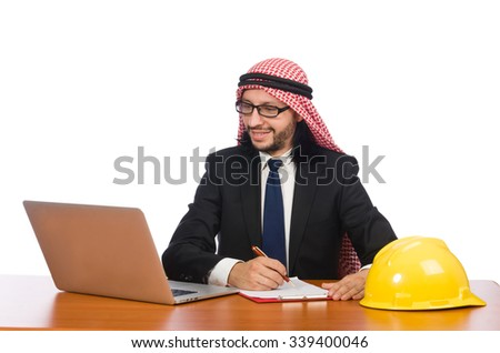 Arab man with computer and hardhat - stock photo