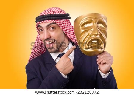 Arab man with mask on white - stock photo