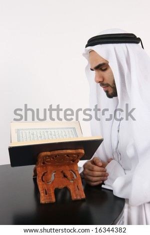 Arab Muslim Man Reading The Holy Quran - stock photo