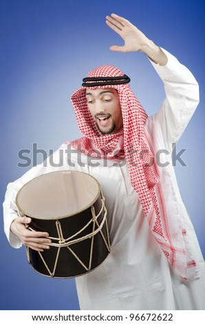 Arab playing drum in studio shooting - stock photo