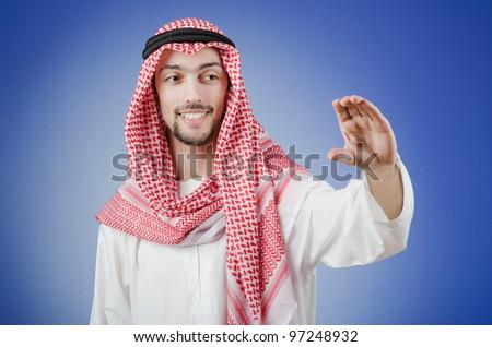 Arab pushing virtual buttons - stock photo