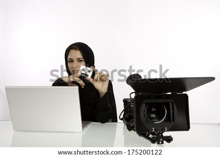 Arab Student Holding Her Show Reel In A Filming Studio - stock photo
