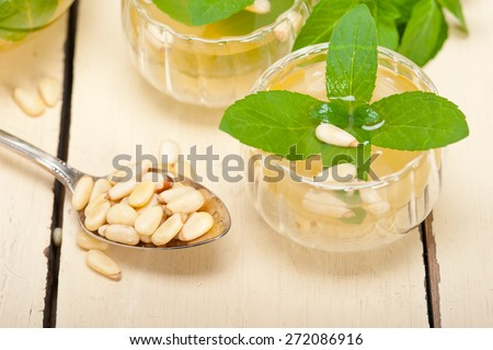 Arab traditional style  mint and pine nuts tea called  at tay - stock photo