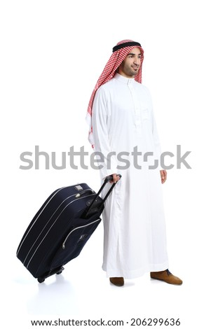 Arab traveler saudi man carrying a suitcase isolated on a white background                 - stock photo