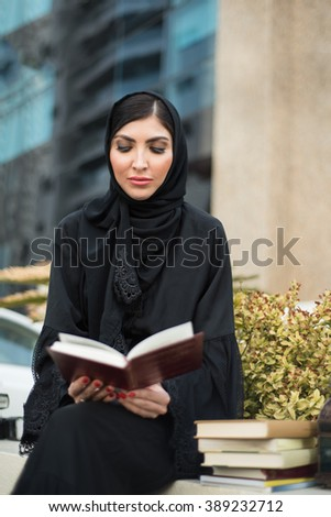 Arab Woman Reading a Book - stock photo