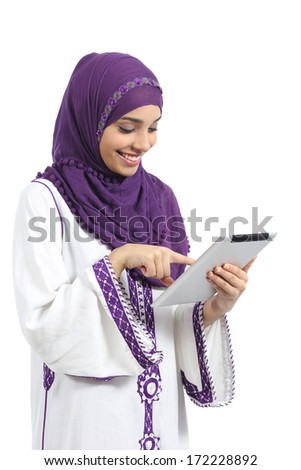 Arab woman reading and touching a tablet, isolated on a white background          - stock photo
