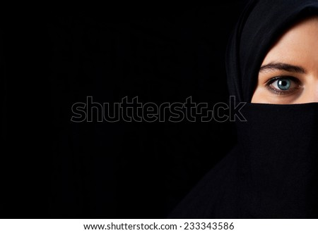 Arab woman with black veil - space for inscription - stock photo