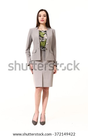 arabian asian eastern brunette business executive woman with straight hair style in gray official two pieces jacket and skirt suit high heels shoes full length body portrait standing isolated on white - stock photo