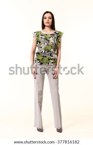 arabian asian eastern brunette business executive woman with straight hair style in khaki sleeveless blouse trousers high heels shoes stand full body length isolated on white - stock photo