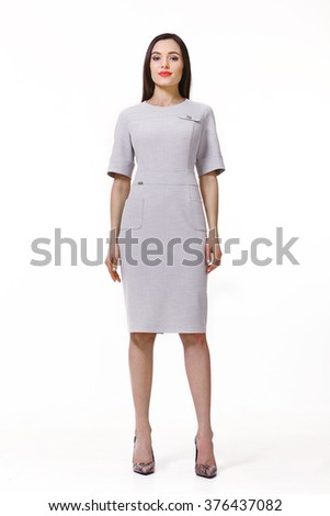 arabian asian eastern brunette business executive woman with straight hair style in party dress belt high heels shoes full length body portrait standing isolated on white - stock photo