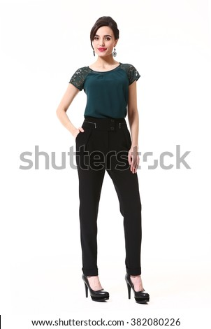 arabian asian eastern brunette business executive woman with updo hair style in office t-shirt and black trousers high heel shoes standing full body length  isolated on white - stock photo