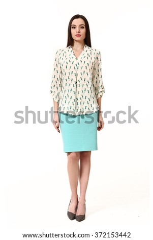 arabian asian eastern brunette student woman with straight hair style in casual printed shirt  blouse and blue skirt high heels shoes full length body portrait standing isolated on white - stock photo