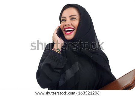 Arabian business woman holding a folder and talking on the phone isolated on white - stock photo