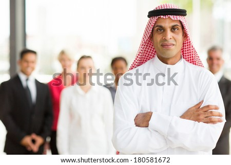 Arabian businessman with colleagues on background - stock photo