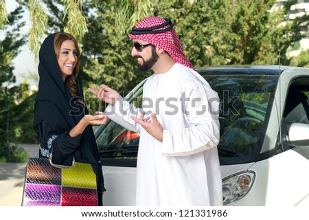 Arabian Couple outdoors having fun time - stock photo