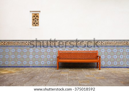 Arabian exterior with bench, wall with and window - stock photo