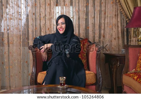 arabian lady with hijab relaxing at her home - stock photo