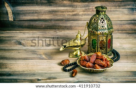 Arabian lantern, dates and rosary. Islamic holidays concept. Vintage style toned picture. Vibrant colors - stock photo