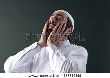 arabian muslim man praying  - stock photo